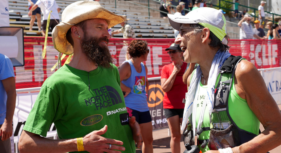 """Rob Krar and Gunhild Swanson at the finish of The Western States 100 Mile Endurance Run 2015"""